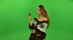 Daring beautiful girl talking on the phone Stock Footage