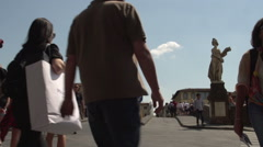 People taking pictures of statues Ponte Santa Trinita Stock Footage
