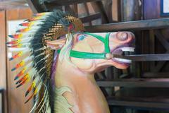 Stock Photo of Head of horse statue with an Indian headdress of feathers