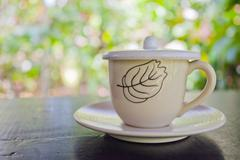 One white cup of aromatic coffee - stock photo