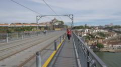 People taking a walk on Dom Luis bridge in Porto Stock Footage