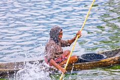 Indonesian fisherman fishing on a boat Stock Photos