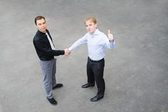 A business partners concluded a bargain on the street Stock Photos