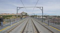Walking and riding bikes on Dom Luis Bridge in Porto Stock Footage