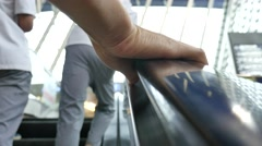 People holding the handrail at escalator Stock Footage