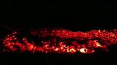Bonfire in the woods raking hot coals Stock Footage