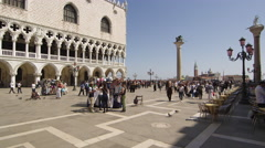 Slow motion shot of crowds in front of Doge's Palace in Piazza San Marco Stock Footage