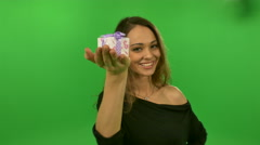 Sexy girl shows on a palm a gift greenscreen Stock Footage