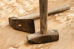 Old used hammer and adze - stock photo
