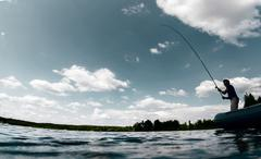 Fisherman on the pond - stock photo