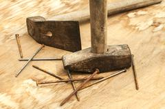 Old used hammer, adze and rusty nails Stock Photos