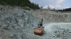 A large excavator for work in quarry. Aerial view Stock Footage