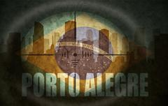 sniper scope aimed at the abstract silhouette of the city with text Porto Ale - stock illustration
