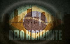 Stock Illustration of sniper scope aimed at the abstract silhouette of the city with text Belo Hori