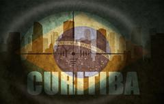 sniper scope aimed at the abstract silhouette of the city with text Curitiba - stock illustration