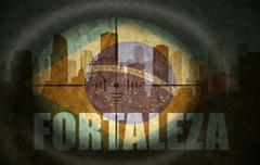 Sniper scope aimed at the abstract silhouette of the city with text Fortaleza Stock Illustration