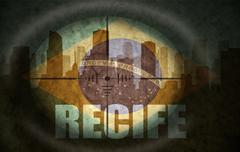 Sniper scope aimed at the abstract silhouette of the city with text Recife at Stock Illustration