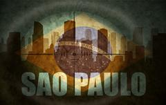 Sniper scope aimed at the abstract silhouette of the city with text Sao Paulo Stock Illustration