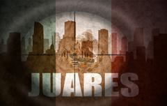 sniper scope aimed at the abstract silhouette of the city with text Juarez at - stock illustration