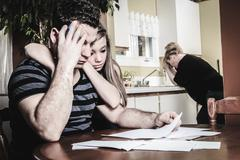 Men with financial stress at home Stock Photos