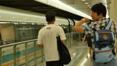 Chinese traveler getting off the maglv train to PUdong airport Stock Footage