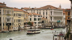 Boats passing by on a Venetian canal Stock Footage
