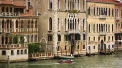 Boat passing by buildings in Venice Stock Footage