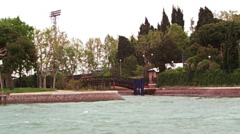 Tracking shot of a wooded park in Venice, from a water taxi Stock Footage