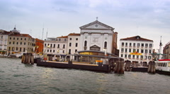 Buildings, including Roman Catholic church, from canal in Venice. Stock Footage