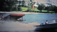FT. LAUDERDALE, USA - 1957: Waterskiing showcase with daredevil men jumping Stock Footage
