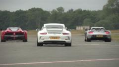 Supercars on track - rear shot Stock Footage