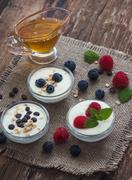 Yogurt with Fruits or Chocolate in Little Bowls Stock Photos