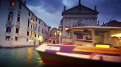 Water taxi passes in front of San Stae Stock Footage