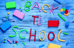 back to school written with modelling clay of different colors - stock photo