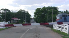 Passenger train moves through the railway crossing Stock Footage