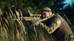 Man takes aim with a rifle - stock footage