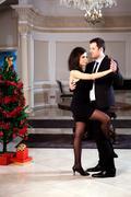 A man and a woman dancing tango. - stock photo