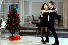 A man and a woman dancing tango. Please see more images from the same shoot. - stock photo