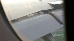 Airplane window view of the wings. Airplane preparing to land. Transportation Stock Footage