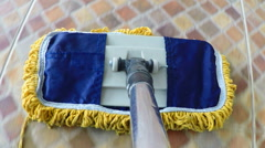 First-person POV floor cleaning mop in action closeup Stock Footage