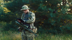 Armed man working with tablet Stock Footage