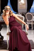 Sensual blonde with a mask, sitting in a ballroom Stock Photos