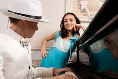 Lovely young lady listen to his boy a song. Stock Photos