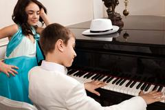 Lovely young lady listen to his boy a song. - stock photo