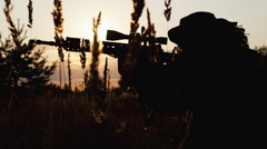 Silhouette of man with sniper rifle. Airsoft game Stock Footage