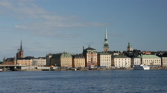Ferry arriving at Gamla stan old town Stockholm Sweden Stock Footage