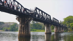 Speed video of Kwai river bridge with tourism Stock Footage