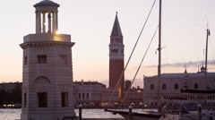 Tilting down shot of Piazza San Marco to the wharf and canal. Stock Footage