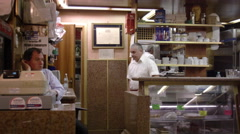 Static slow shot of three men working in an Italian cafe. Stock Footage