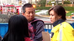 One side of socail service woman comforting affected households. Stock Footage